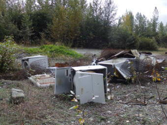 At an informal, and illegal, dump 25 miles out the Haines Highway, residents have tossed everything from old washing machines to broken chest freezers. (Photo by Abbey Collins/KHNS)