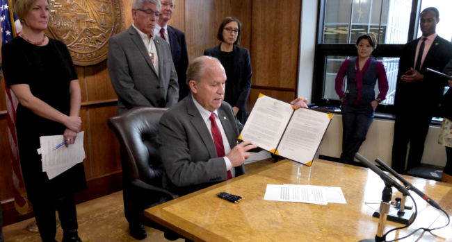 Alaska Gov. Bill Walker shows off the freshly signed Administrative Order 289 in the state Capitol on Oct. 31, 2017. The order establishes the Alaska Climate Change Strategy and Climate Action for Alaska Leadership Team. (Photo by Skip Gray/360 North)