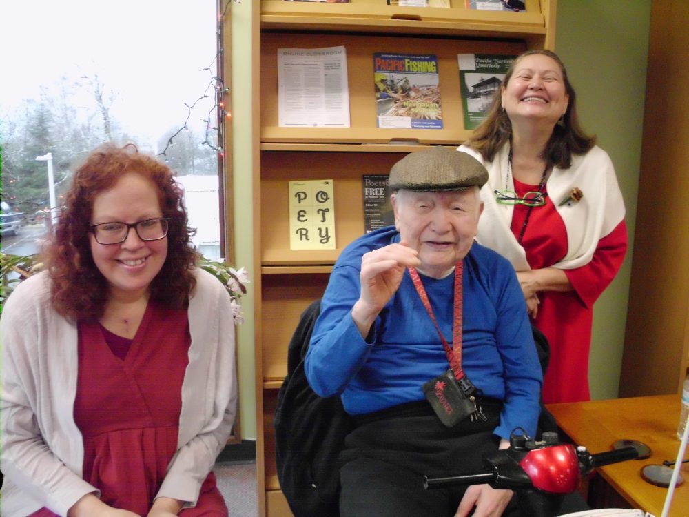 Victoria McKoy, left, John Russell Reese and Terri Burr pose during McCoy's capstone presentation on Nov. 30 at the University of Alaska Southeast Ketchikan Campus Library. (Photo by Maria Dudzak/KRBD)