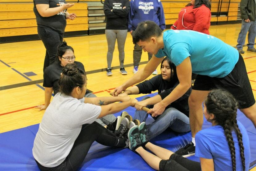 Athletes compete in the Eskimo Stick Pull. (Photo by Adelyn Baxter/KTOO)