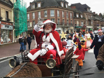 Retired American photographer Tom Haley, 66, portrays Santa during a pageant in Normandy. (Photo by Eleanor Beardsley/NPR)