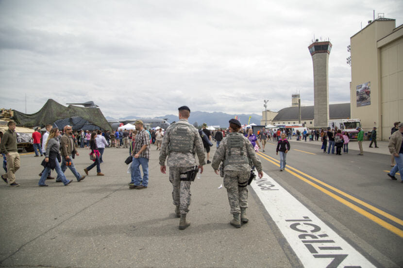Members of the U.S. Air Force 673rd Security Forces Squadron patrol during the Arctic Thunder Open House at Joint Base Elmendorf-Richardson on July 31, 2016.