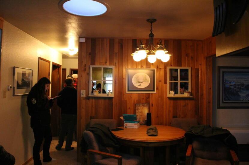 The energy assessors inventory a Juneau house. (Photo by Elizabeth Jenkins/Alaska's Energy Desk)