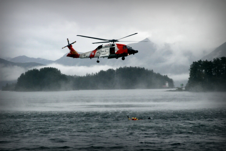 Although most people imagine the crews of Coast Guard Air Station Sitka routinely plucking mariners from sinking ships, the most common mission is the non-maritime medevac in flight conditions too treacherous for any other aircraft than the all-weather Jayhawk. Air Station Sitka also performs more terrestrial Search and Rescues (lost hunters and hikers) than any other unit in the Coast Guard. (Photo by Emily Russell/KCAW)