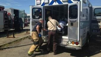 A woman is loaded into an ambulance in Huntington, West Virginia, following an opioid overdose rescue. Experts say a decline in overdose deaths in 14 states is due in part to increased use of the overdose antidote naloxone. (Photo by Pew Charitable Trusts)