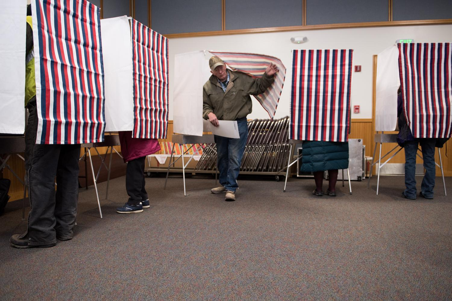 Bill Ferguson exits a voting booth at the Yupiit Piciryarait Cultural Center, one of two available precincts in Bethel, Alaska on November 8, 2016. (Photo by Katie Basile/KYUK)