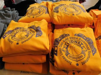 Gold Medal sweatshirts are among tournament gear sold to offset costs and support scholarships and other programs in Southeast Alaska. (Photo by Ed Schoenfeld, CoastAlaska News)