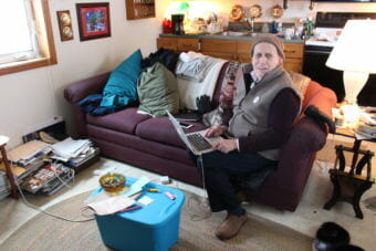 Richard Beneville rents his house in Nome. He shares the space with his cat, Ollie. (Photo by Elizabeth Jenkins/Alaska's Energy Desk)