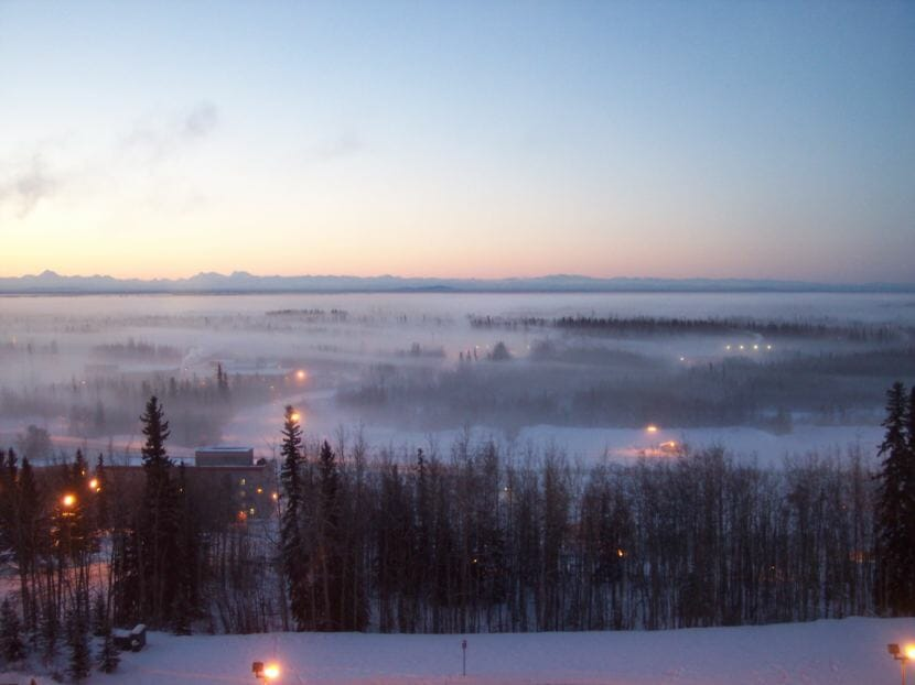 Ice fog hangs over Fairbanks during a weather inversion on Jan. 21, 2003. This is facing South from the eighth floor of Bartlett Hall at the University of Alaska Fairbanks.