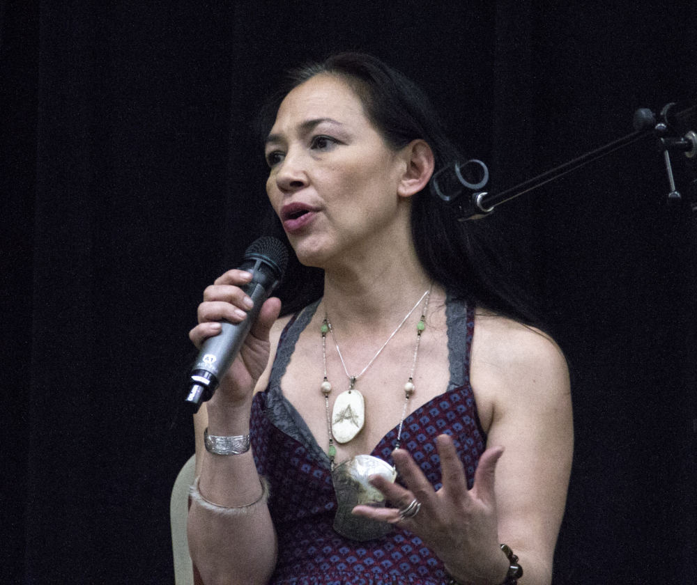 """Actress Irene Bedard talks about raising her son and her sister, who were abused and sex trafficked, during """"An Evening of Stories,"""" an event Monday, April 23, 2018, to raise awareness of domestic violence and sexual assault, at the Elizabeth Peratrovich Hall in Juneau. (Photo by Tripp J Crouse/KTOO)"""