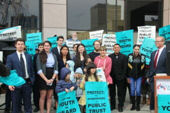 The young plaintiffs in Sinnok v State of Alaska gathered with their attorneys and supporters outside the Nesbett Courthouse in downtown Anchorage after oral arguments on Monday, April 30. The state is asking the court to dismiss their lawsuit. (Photo by Rachel Waldholz / Alaska's Energy Desk)