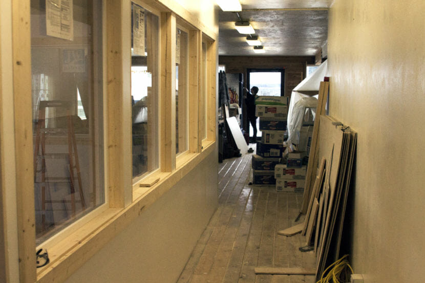 Icy Strait Brewing co-owner Tawney Letterman works on the brewery's remodel of a former downtown Hoonah eatery. (Photo by Tripp J Crouse/KTOO)
