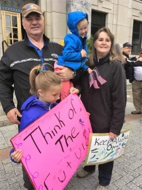 Don Etheridge, his wife and grandchildren take part in a demonstration supporting public employees and construction at the Capitol June 11, 2017. Nonpartisan Etheridge is running for Juneau's Senate seat. (Photo courtesy Don Etheridge)