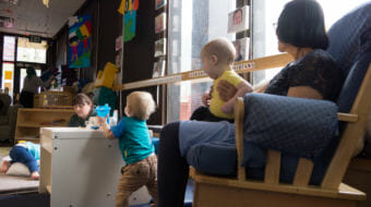Childcare workers interact with infants at Gold Creek Child Development Center in Juneau on May 11, 2018. State rules require certain square footage and staffing levels, which limit this center's infant care capacity to 10. New state rules being proposed may force that capacity down to 8.