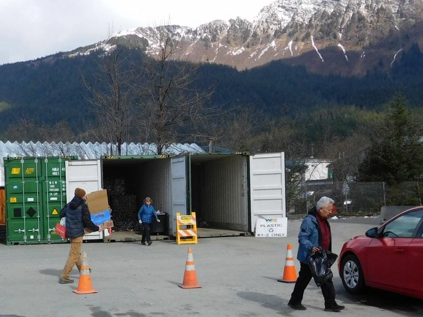 Juneau residents drop off cardboard, paper, aluminum and plastics at the Juneau Recycling Center on March 28, 2018. (Photo by Ed Schoenfeld/CoastAlaska News)