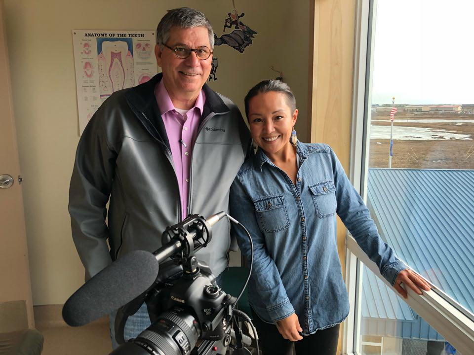 Indian Country Today editor Mark Trahant, left, and videographer Jacqueline Cleveland reporting for FIrst Nations Experience or FNX TV on the Dental Health Aide Therapist program housed at Yuut Elitnaurviat in Bethel. May 3, 2018. (Photo by Christine Trudeau/KYUK)