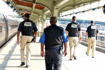 Department of Homeland Security and Transportation Security Administration agents work in 2015 at an Amtrak station. (Photo by Barry Bahler/Department of Homeland Security)