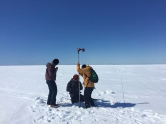 Arctic Field School students taking measurements on Elson lagoon as part of field school. Some of their time was spent getting instruction from professors, and some was spent working on answering research questions they formulated out in the field.