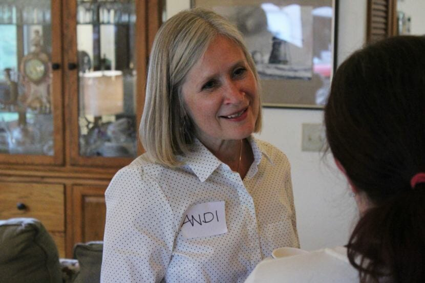 District 34 candidate Andi Story speaks with a voter during a campaign event on July 18, 2018. (Photo by Adelyn Baxter/KTOO)