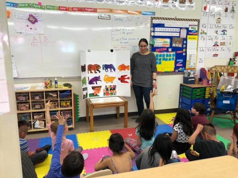 "Mique'l Dangeli teaches primary students to read ""Brown Bear, Brown Bear, What do You See"" in Sm'algyax. (Photo courtesy Mique'l Dangeli)"