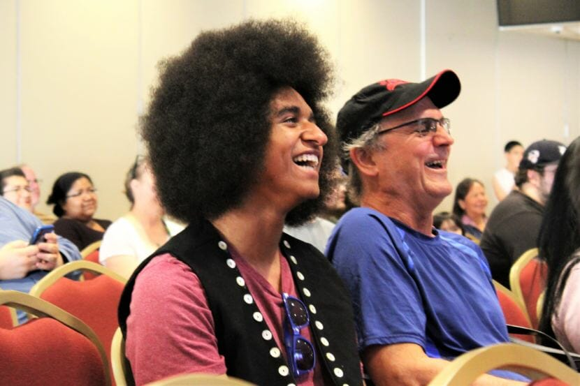 "AJ Hoyle laughs during the premiere of ""Ix̱six̱án, Ax̱ Ḵwáan (I Love You, My People)."" (Photo by Adelyn Baxter/KTOO)"
