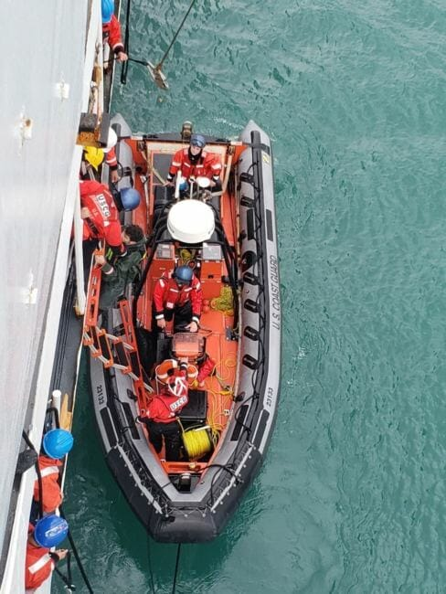 The Coast Guard helps bring a rescued kayaker aboard the Douglas Munro in Glacier Bay on July 15, 2018.