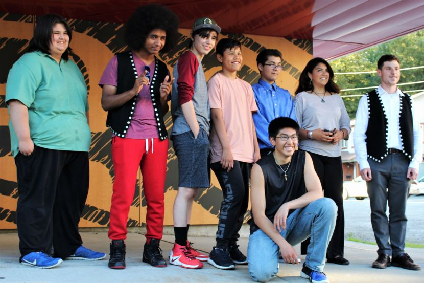 (From left to right) Teenagers Arturo Rodriguez, AJ Hoyle, Keegan Kanan, Bradley Dybdahl, Jacob Brouillette, Marcel Cohen and Kenndra Willard pose with Will Kronick from the Central Council of Tlingit and Haida on July 30, 2018. (Phot by Adelyn Baxter/KTOO)