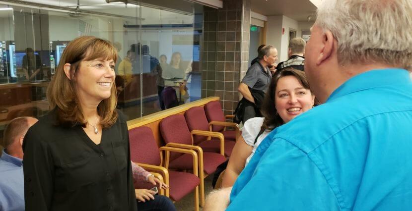 Juneau School Board member Emil Mackey congratulates Bridget Weiss for being selected interim superintendent of the Juneau School District on Monday, Aug. 6, 2018.