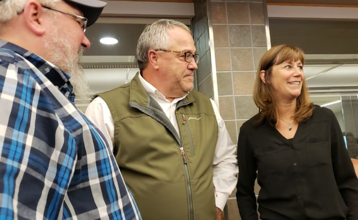 Bridget Weiss smiles and accepts congratulations after a Juneau School Board meeting adjourned in which she was selected interim superintendent of the Juneau School District on Monday, Aug. 6, 2018.