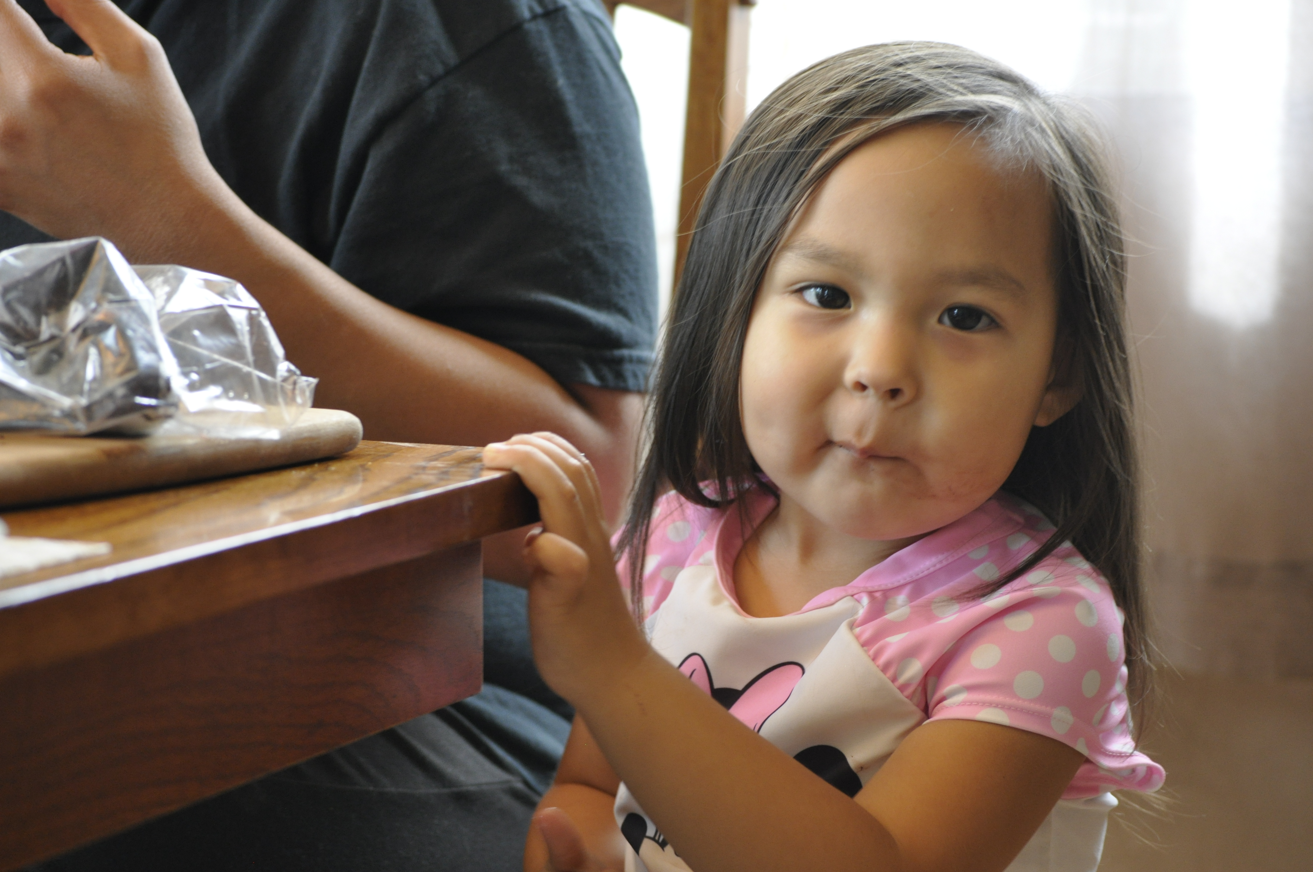 Alesha Tangman's daughter Lucy steals bites of Maktak from her mother's plate. She loves eating the dish with Kunniak's Salt and Spice mixture. (Photo by Erin McKinstry/Alaska Public Media)
