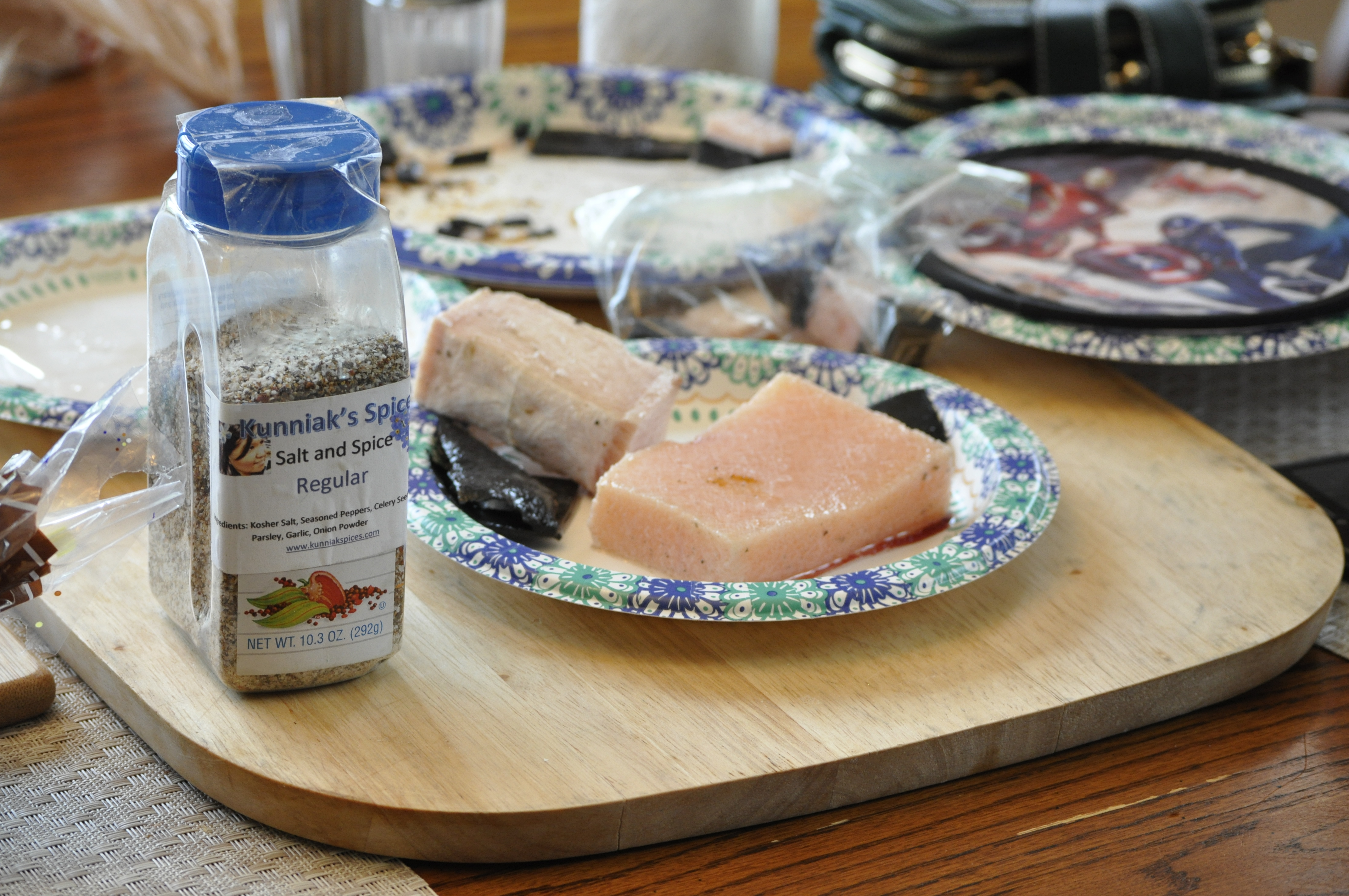 """Kunniak's original Salt and Spice mixture next to a plate of bowhead whale. She now carries 11 different flavors, including """"Black Lava"""" and """"Ghost Blend."""" (Photo by Erin McKinstry/Alaska Public Media)"""