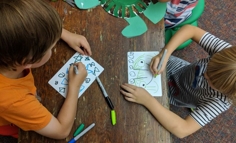 Children draw at the Kindergarten Boot Camp at Harborview Elementary School in summer 2018. It was the first year the Juneau School District put together the school-readiness camp.