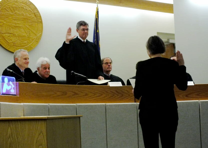 Alaska Supreme Court Chief Justice Joel Bolger administers the oath of office to Superior Court Judge Amy Gurton Mead. Watching, seated from far left, is Juneau Superior Court Judge Philip Pallenberg, Senior Judge Louis Menendez, and Ketchikan Superior Court Judge William Carey.