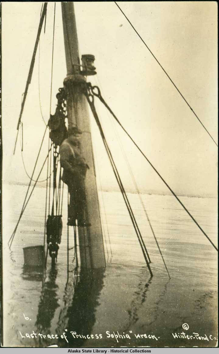 This archival photograph shows a man standing on the mast of the sunken Princess Sophia. (Photo courtesy of Alaska State Library)