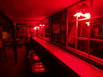 One never feels like they're drinking alone in the Alaskan Hotel's eerily-lit back bar. (Photo by Jacob Resneck/CoastAlaska)