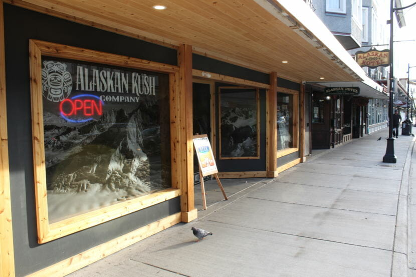 An open signs lights up the window of the Alaskan Kush Company in downtown Juneau. (Photo by Adelyn Baxter/KTOO)