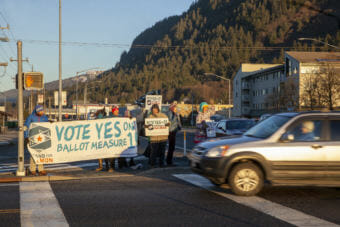 Ballot Measure 1 supporters greet early morning commuters on Election Day, Tuesday, November 6, 2018, in Juneau, Alaska.