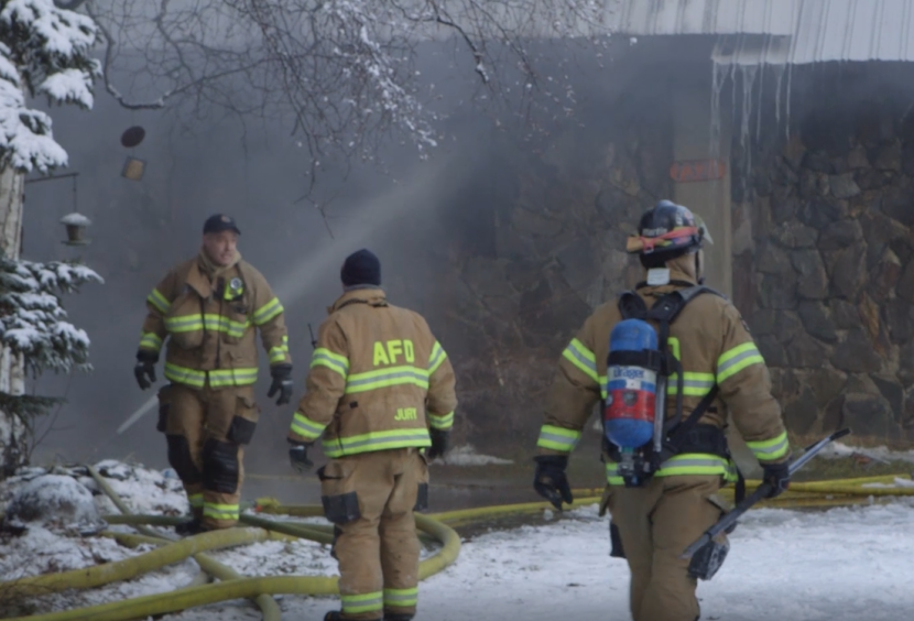 Anchorage Fire Department firefighters respond to a call after an earthquake rocked Anchorage on Nov. 30, 2018. (Video still by Joey Mendolia/Alaska Public Media)