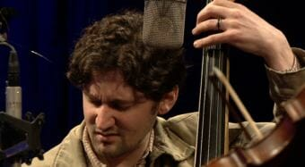 Video still of Ryan Bowers playing bass at KTOO during the 2018 Alaska Folk Festival. He's performing with the Fairbanks band Ryan Bowers and the Brain Trust for a Red Carpet Concert.
