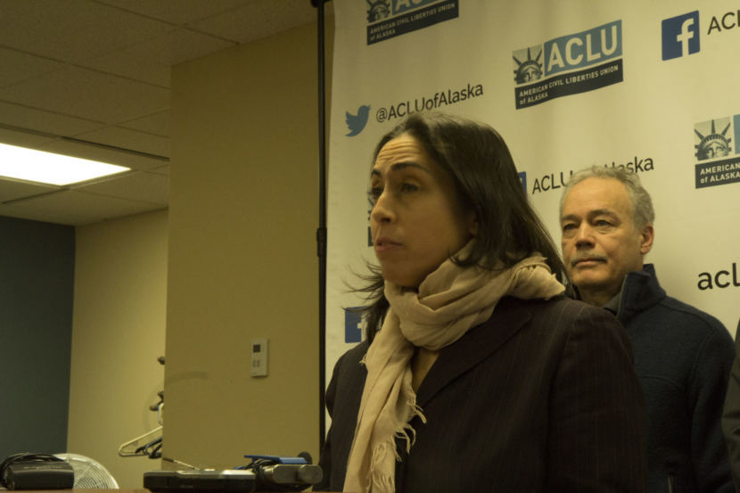 Former Assistant Attorney General Libby Bakalar speaking at a press conference on Thursday. Bakalar is one of three plaintiffs in lawsuits filed by the ACLU of Alaska against the Dunleavy administration, claiming that she was illegally terminated by the governor. Former Alaska Psychiatric Institute Staff Psychiatrist Dr. John Belville (right) is another plaintiff. (Photo by Wesley Early, Alaska Public Media)