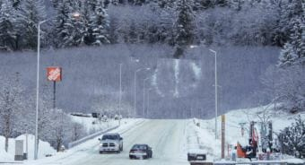 The alder trees -- and the peace sign among them -- at the end of Commercial Boulevard in Juneau are about 10 years old, pictured here on Jan. 8, 2019. The slope was cut and stabilized as part of the construction of the Home Depot.
