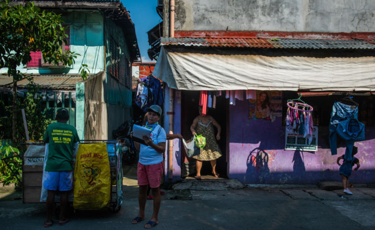 """The Baritan neighborhood in Malabon city has adopted a """"zero waste"""" policy that requires citizens to sort their trash and separate out the plastic. Above, trash collectors at work. (Photo by Jes Aznar for NPR)"""
