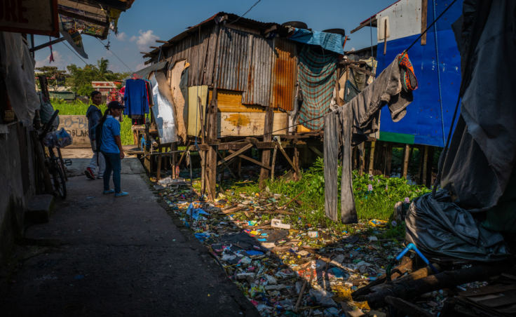 Because the plastic sachets that hold food and other consumer goods can't be recycled, independent waste pickers don't collect them and they end up everywhere. (Photo by Jes Aznar for NPR)