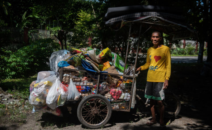 Alex Fruelda, 59, has been a garbage collector in San Fernando city, north of Manila, for nearly 10 years. Officials say the city recycles or composts 85 percent of its waste. (Photo by Jes Aznar for NPR)