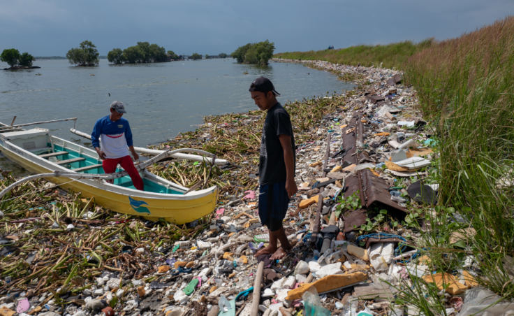 This line of garbage extends all the way around the shore of the Navotas neighborhood in Manila.