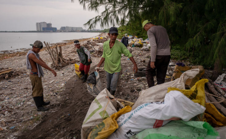 Workers collect and sort garbage on Freedom Island. (Photo by Jes Aznar for NPR)