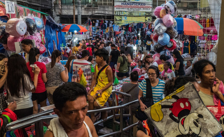 Manila vies for the title of most densely populated city in the world. At the city's crowded markets, like the one above, increasing income has boosted the sales of consumer goods packaged in plastic. (Photo by Jes Aznar for NPR)