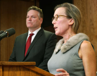 Office of Management and Budget Director Donna Arduin helps Gov. Michael Duleavy explain various aspects of his proposed state budget at a press availability in the Capitol in Juneau on Feb.13, 2019.