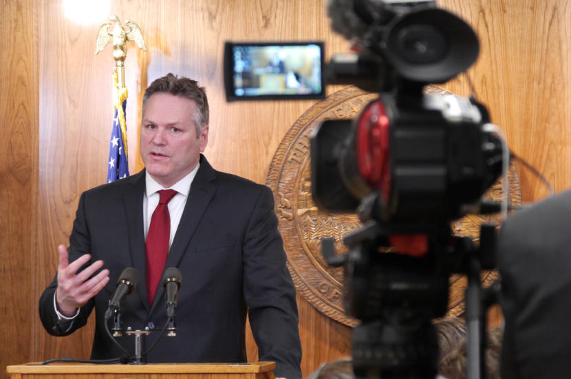 Gov. Michael Dunleavy introduces his amended state budget to reporters at a press availability at the Capitol in Juneau on Feb. 13, 2019.