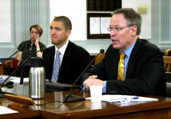 Department of Revenue Commissioner-designee Bruce Tangeman, right, presents the spring revenue forecast to the Senate Finance Committee in Juneau on March 18, 2019. He was accompanied by the department economist Dan Stickel.